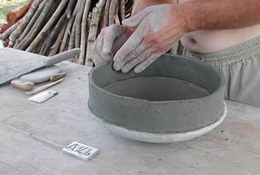 "Fashioning the clay is one of the crucial moments in making a pot; it is time-consuming and laborious. Employing a mould entails using a concave support onto which layers of clay are stuck. To fashion the walls of a pot, the coil technique is used, whereby a series of clay ""sausages"" or rolled strips are laid on top of one another."