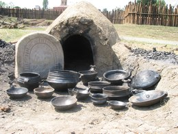 The smaller kiln was used for pots of more modest size. The entire firing cycle, in which temperatures can rise to 800 degrees, takes several hours and requires constant supervision of the fuel and airflow.
