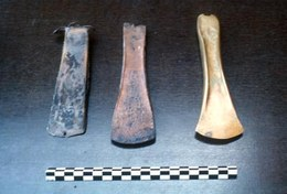 Various stages in manufacturing a bronze axe.