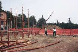 Construction of the first house got underway with the raising of vertical support spars.
